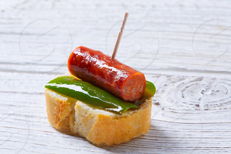 pinchos pintxos chistorra with pepper tapas from Spain sausage food photo