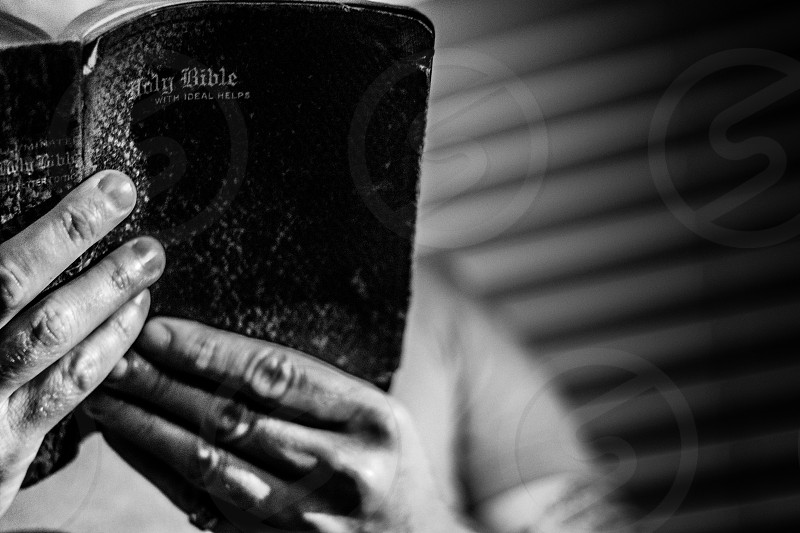 bible read reading book leather religious  black white B&W man tattoo photo
