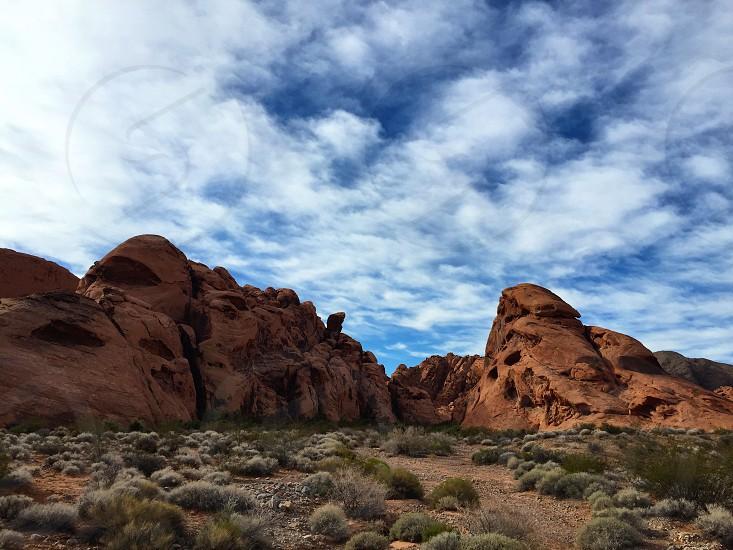 National Park nature red rocks climbing hiking desert Las Vegas Nevada clouds USA petroglyphs  photo