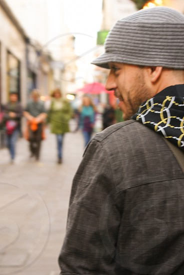 person in black jacket wearing black knit cap in tilt shift lens photography photo
