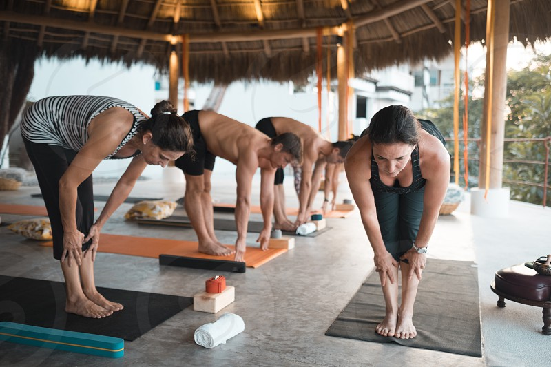 Group of motivated people exercising yoga at a retreat in Mexico photo