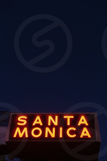 Santa Monica illuminated sign on the Pacific Coast Highway (Route 1) at night. photo