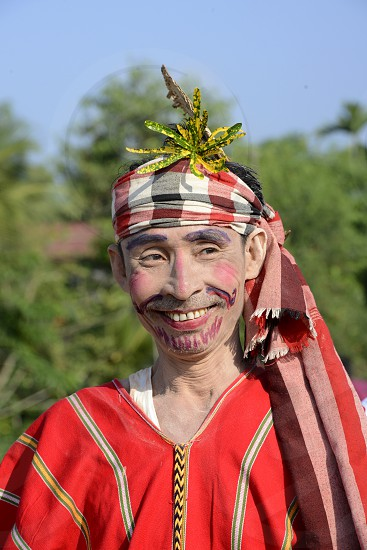 a Clown in traditional dresses at a shinpyu ceremony in a village neat the city of Myeik in the south in Myanmar in Southeastasia. photo