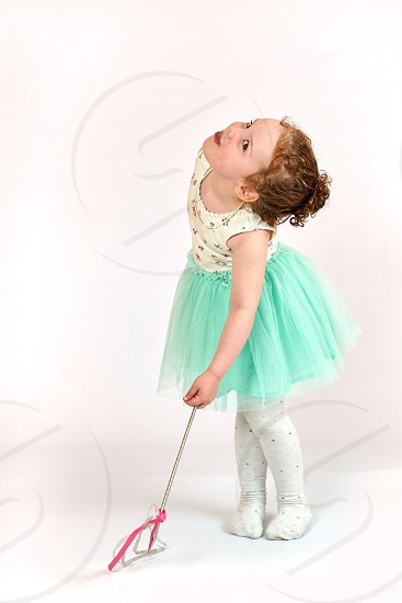 Little girl fashion model in green dress photo