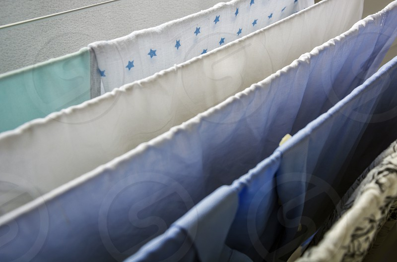 Laundry drying on a clotheshorse with star shaped decorated fabric in focus photo