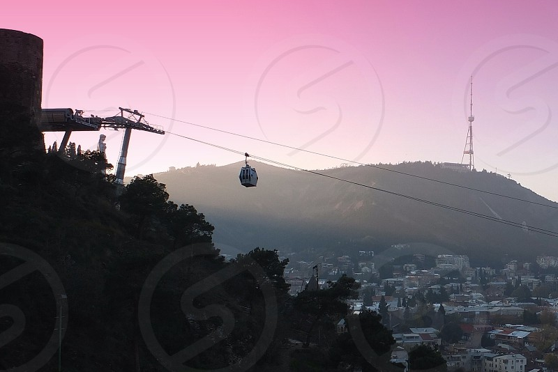 black cable car on top of the hill photo