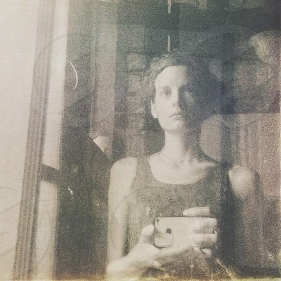 photo of woman holding camera photo
