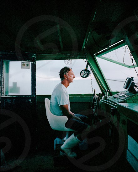 Boat captain cockpit ocean sea fishing photo