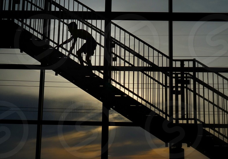 person on stairs silhouette photo