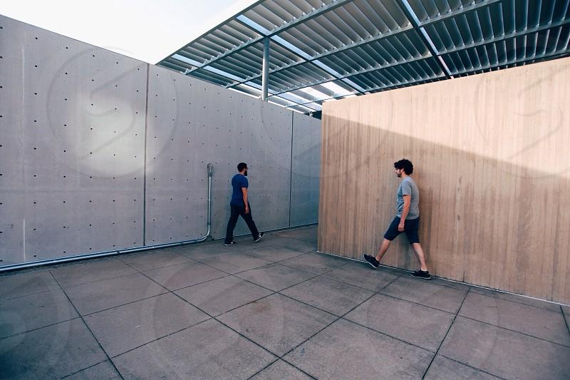 2 men walking to hallway photo