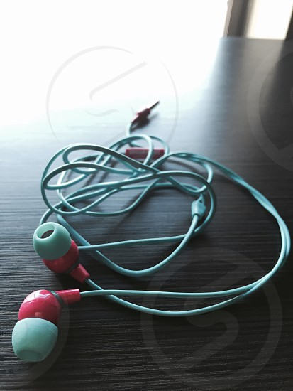 pink and white earphones photo