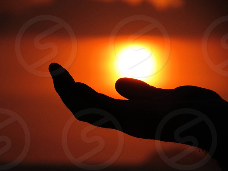 person acting holding sun photo