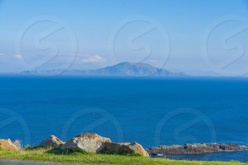 Island in a deep blue sea. Taken at Achill Island Ireland. photo
