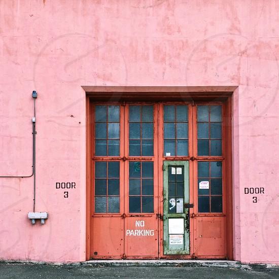 Warehouse doors in pink wall.  photo