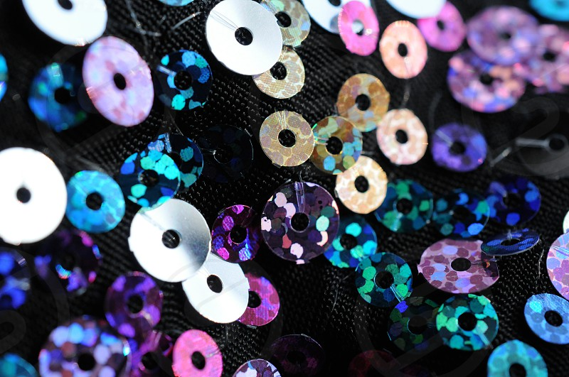 purple and blue sequin photo