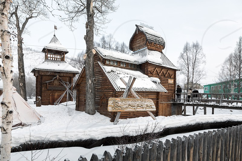 ESSO VILLAGE KAMCHATSKY KRAI RUSSIA - MARCH 09 2013: Winter view of the wooden building Bystrinsky Ethnographic Museum in Bystrinsky Region on Kamchatka Peninsula. Eurasia Russian Far East. photo