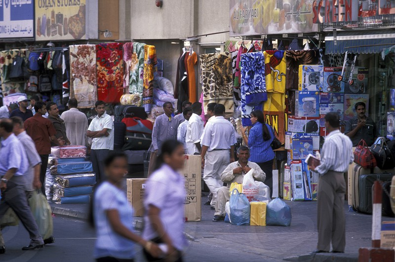 a shopping street in the souq or Market in the old town in the city of Dubai in the Arab Emirates in the Gulf of Arabia. photo