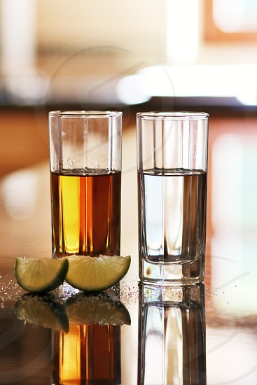 Tequila silver and gold anejo with limes and salt  photo