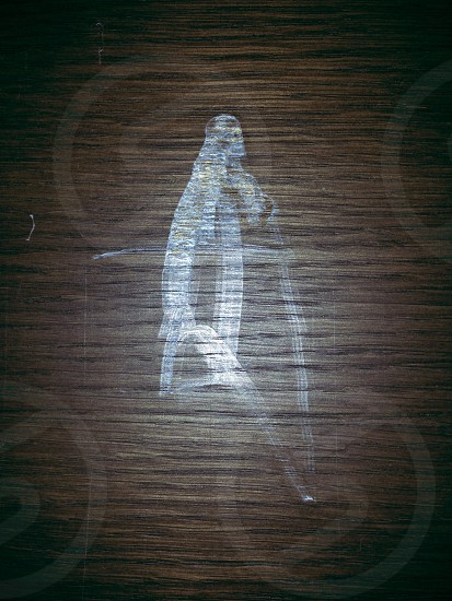 Figure etched in wood: can you guess who? photo