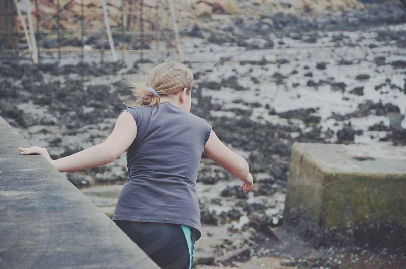 woman in black t shirt walking photo