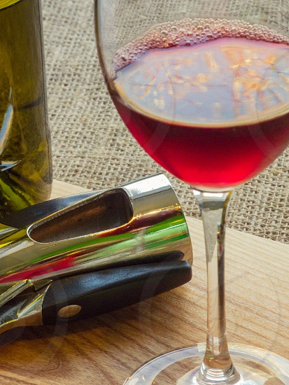 still life with wine bottle and glass on the clothes background photo