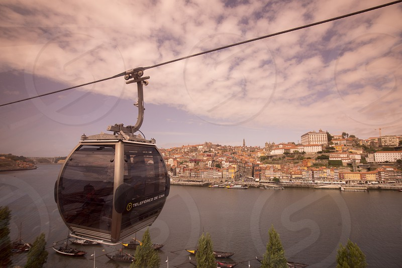 the cablecar and the old town on the Douro River in Ribeira in the city centre of Porto in Porugal in Europe. photo