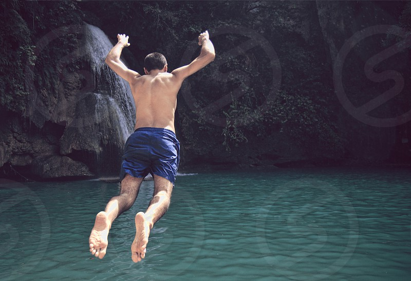Taking the leap at Kawasan Falls in the Philippines photo