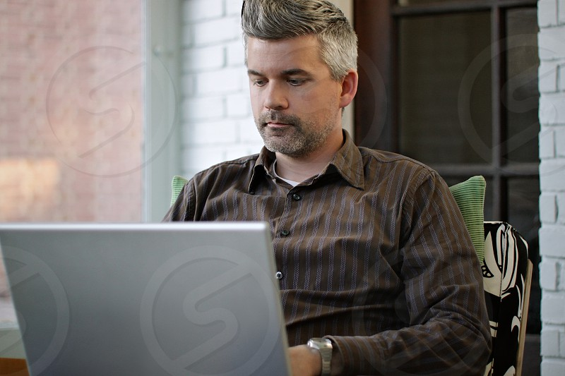 man using white laptop photo