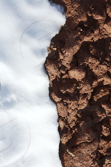 contrast snow and red clay mud soil vertical photo
