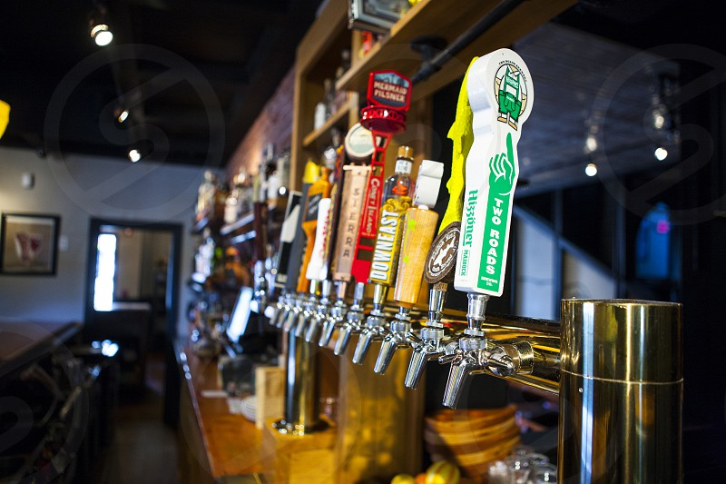 shallow focus photo of beer dispensers in bar photo