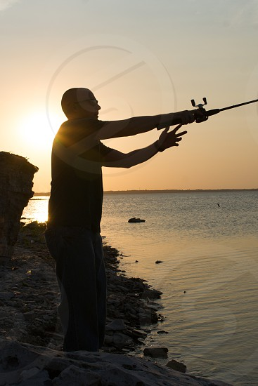 person holding a fishing rod photo