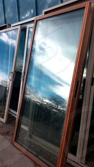 Doors reflecting the beautiful sky photo