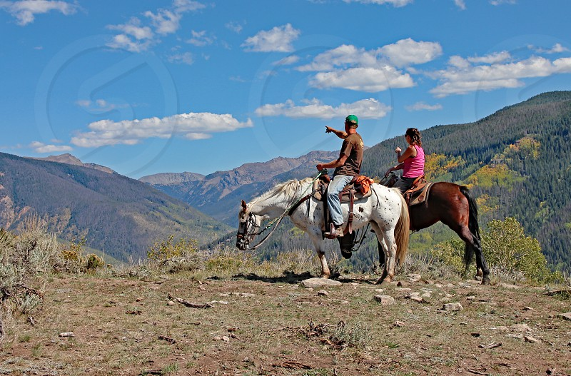 Horseback riders in the mountains near Vail Colorado. photo