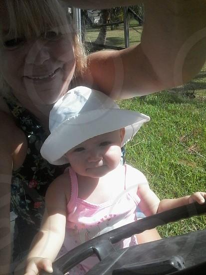 Baby Girl Grandma Outside Driving Sunny Hat. photo