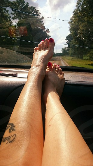 feet going down the road photo