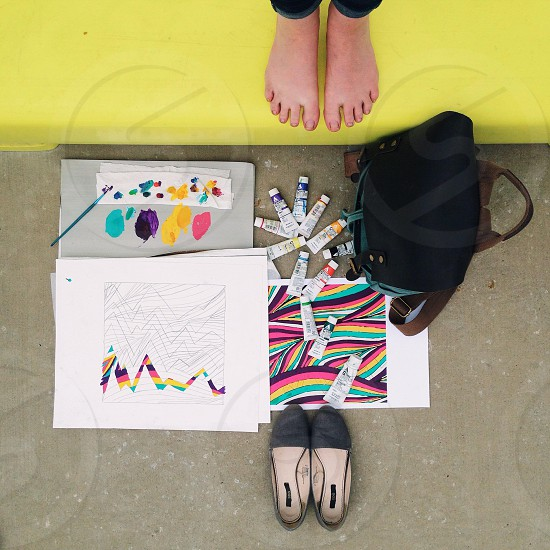 painting supplies lying on concrete floor photo