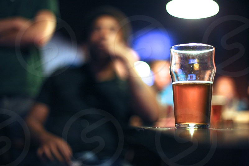 Beer drinking in the sport bar photo