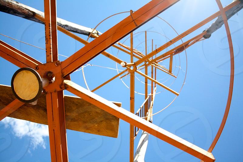 orange steel bars under clear blue sky photo