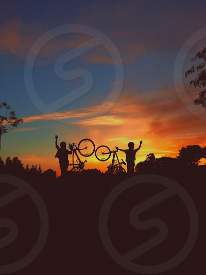 two bmx bikers silhouettes photo