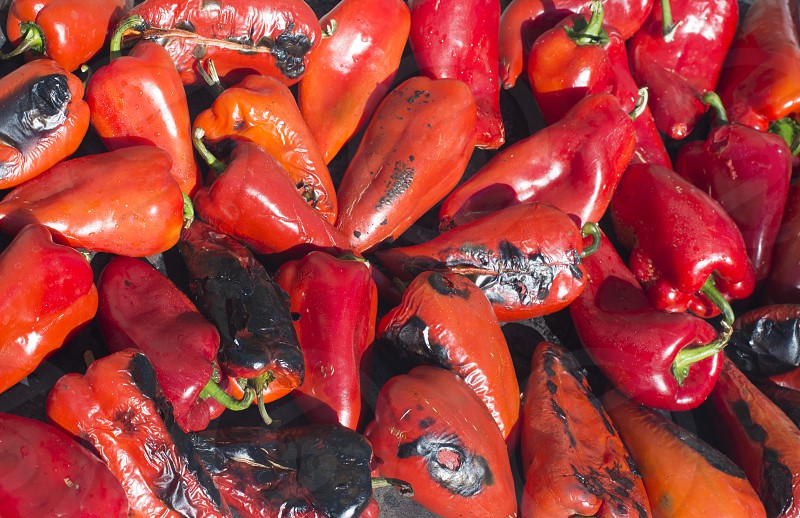 Roasted red peppers background. Sun light photo