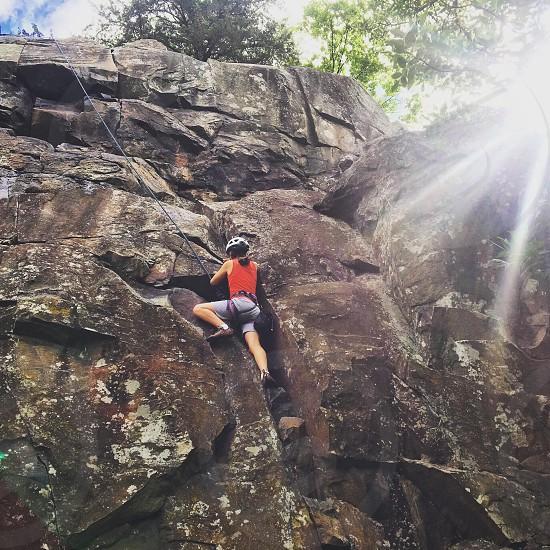 Girl rock climber photo