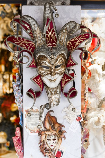 red and silver mask decor photo