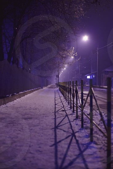 Outdoor scenes of dark streets during night winter season. Traffic moments of a small Balkan town.  photo