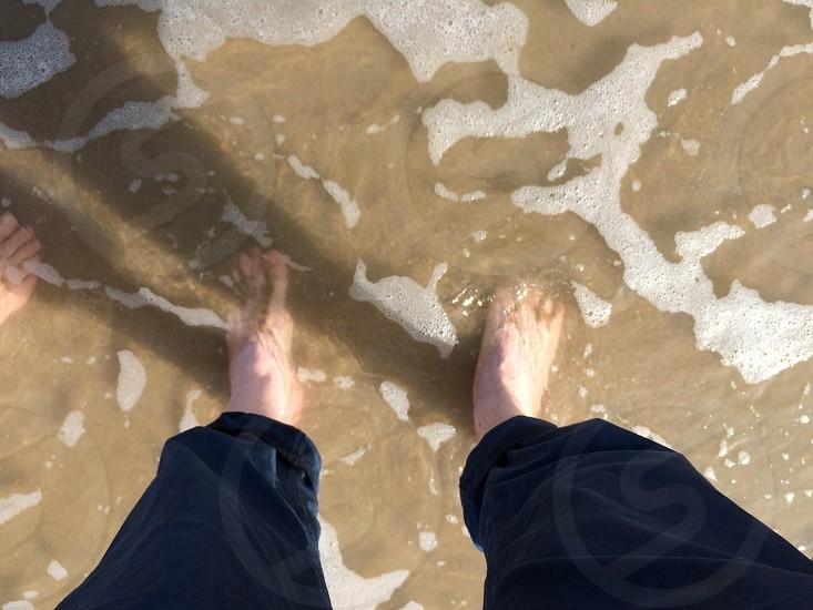 Walking along the shoreline  photo