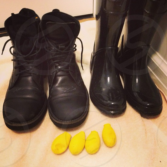 two pairs of black work and rain boots photo