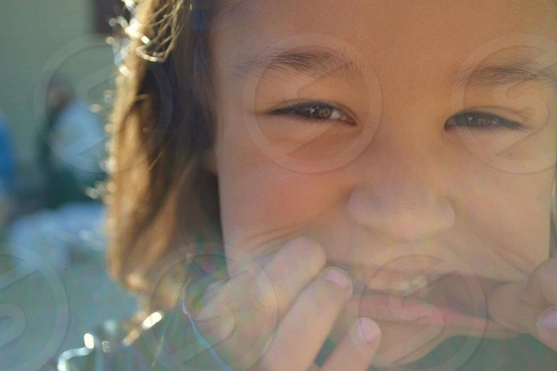 girl holding lip photo