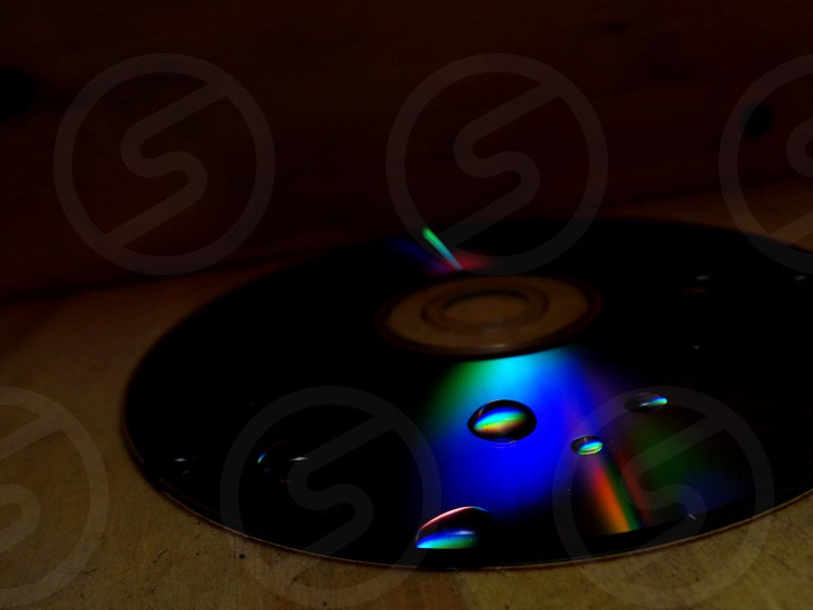 A cd with water droplets on it photo