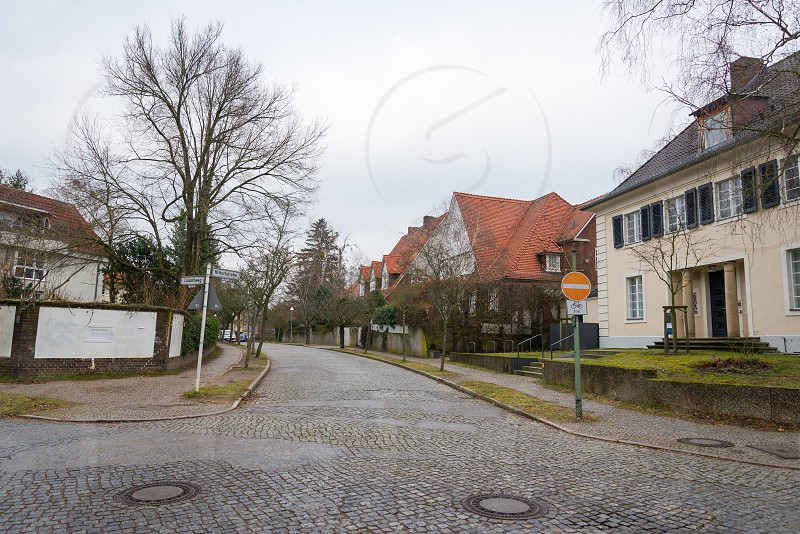 Villas and street in the village between Thielpark and Freie University inside Dahlem Neighborhood in Berlin Germany The Thielpark is a center which nice villas is located around.  photo