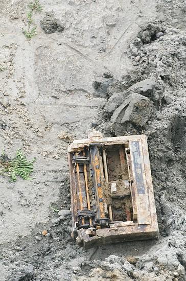 Dirty Old Broken Printer in the Mud Closeup photo