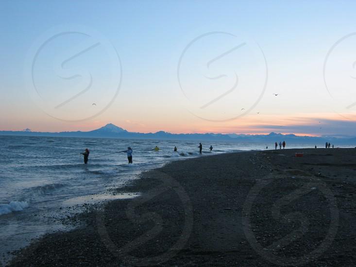 Dip-netting fishing Alaska sunset Kenai beach photo